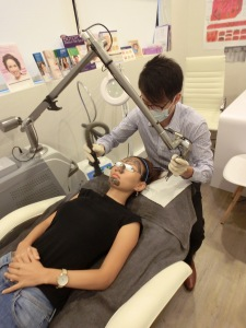 DR DANIEL CHANG performing ACNE Treatment